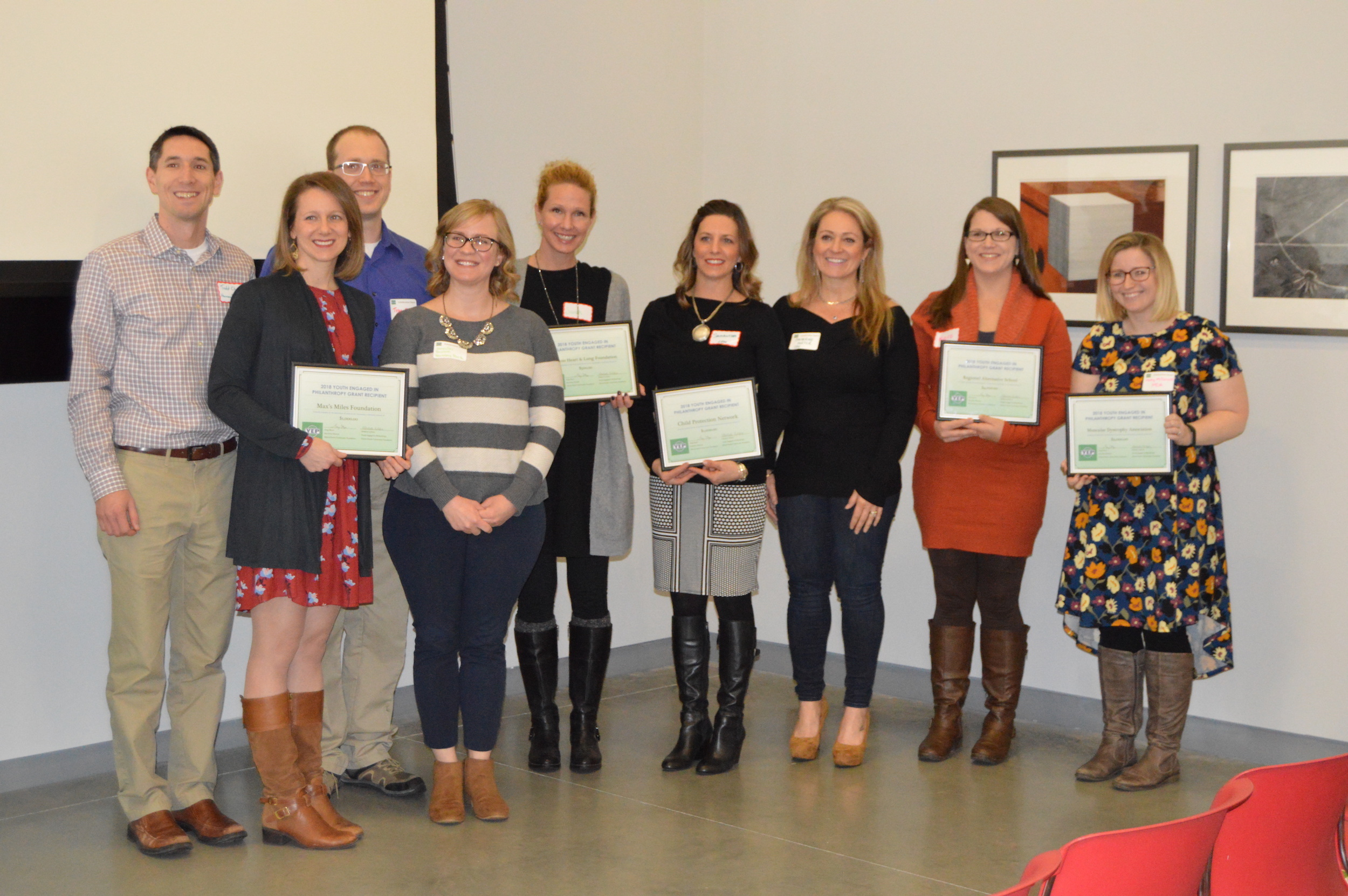 Grant recipients pose with their certificates at the Youth Engaged in Philanthropy (YEP) awards ceremony Sunday afternoon at University Galleries in Uptown Normal. (Image Credit: Breanna Grow)