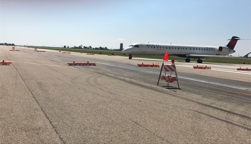 A Delta jet navigates the airfield at CIRA during phase one pavement resurfacing work last year. (Image Credit: Central Illinois Regional Airport)
