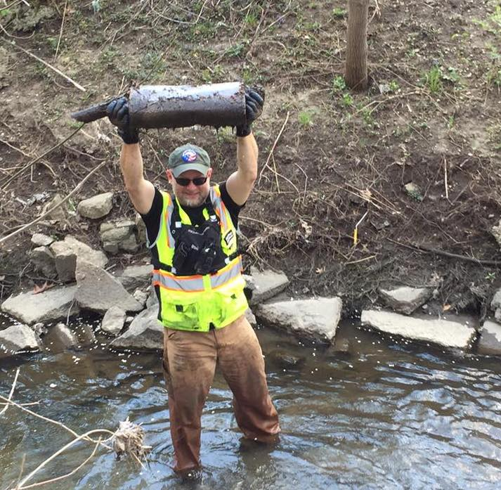 EAC Director Michael Brown lends a hand with the Sugar Creek Stewards program. -