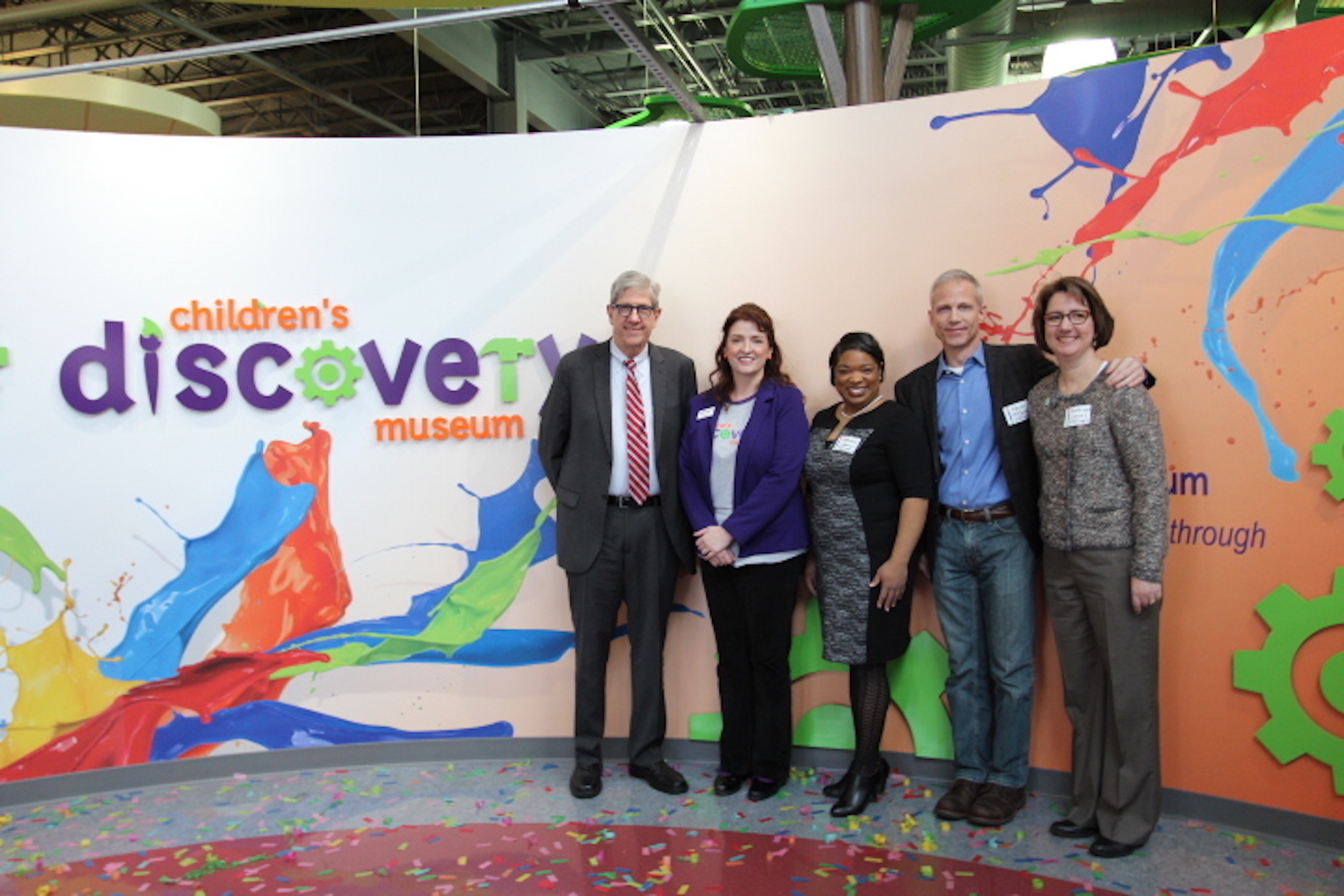 Town of Normal Mayor Chris Koos poses with CDM Director Beth Whisman and Town Council members Chemberly Cummings, Kevin McCarthy and Kathleen Lorenz at the Children's Discovery Museum's logo reveal Tuesday. (Image credit: CDM)