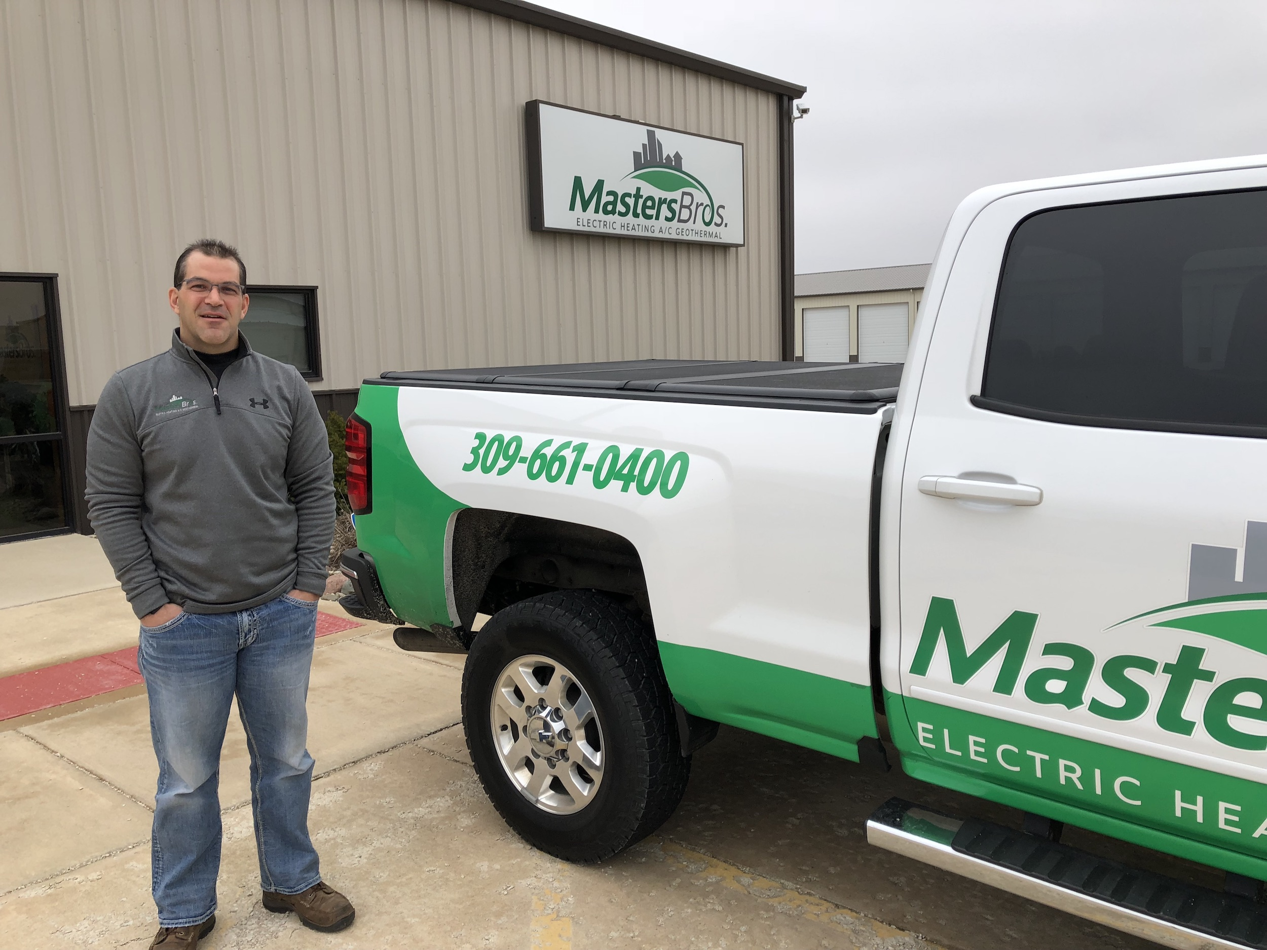 Masters Bros co-owner Rick Masters says their brightly colored green and white fleet helps them market their business.