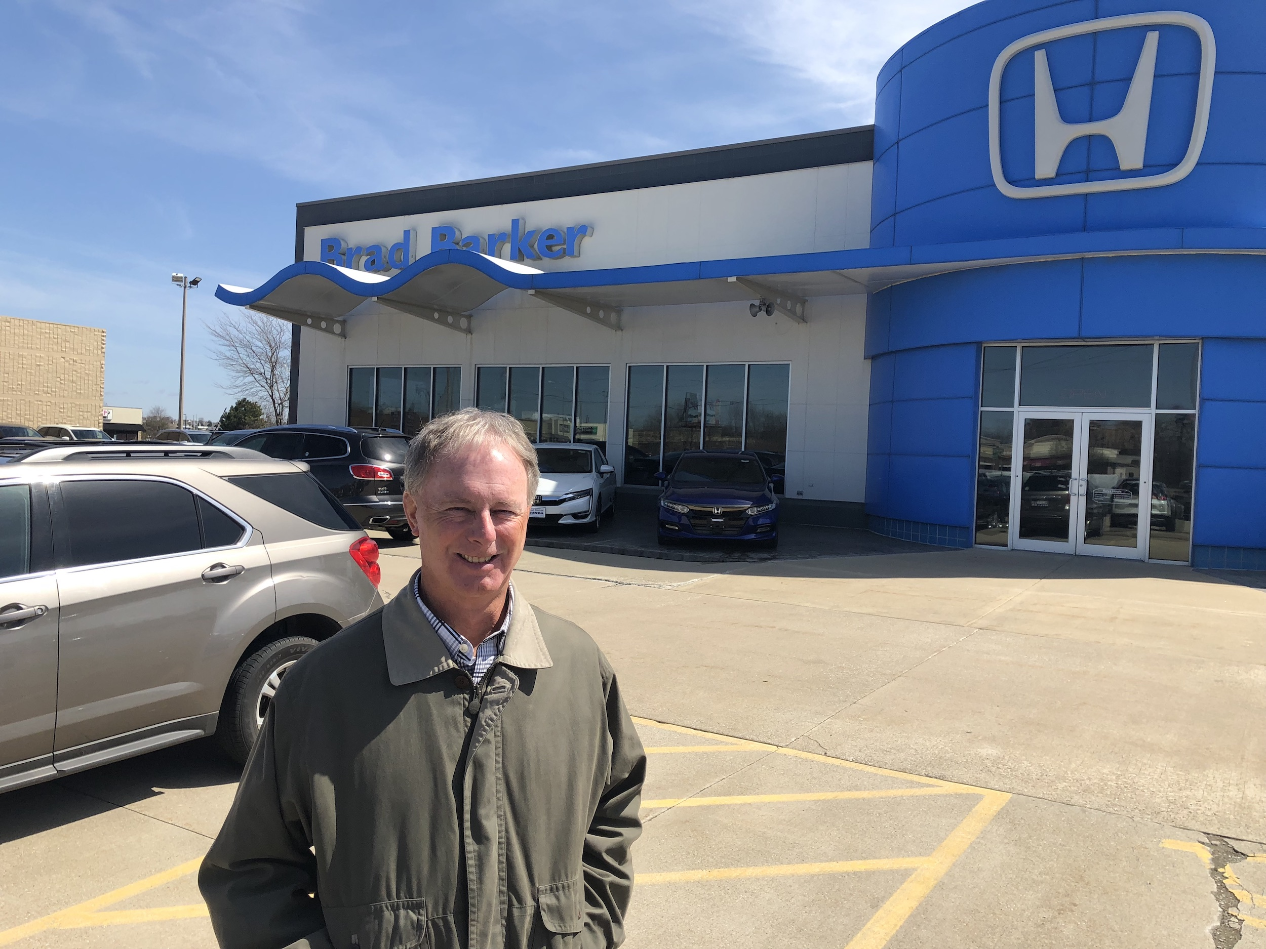 Brad Barker stands outside his Honda dealership, which has stood in this location since 1987. (Image credit: Erik Prenzler)