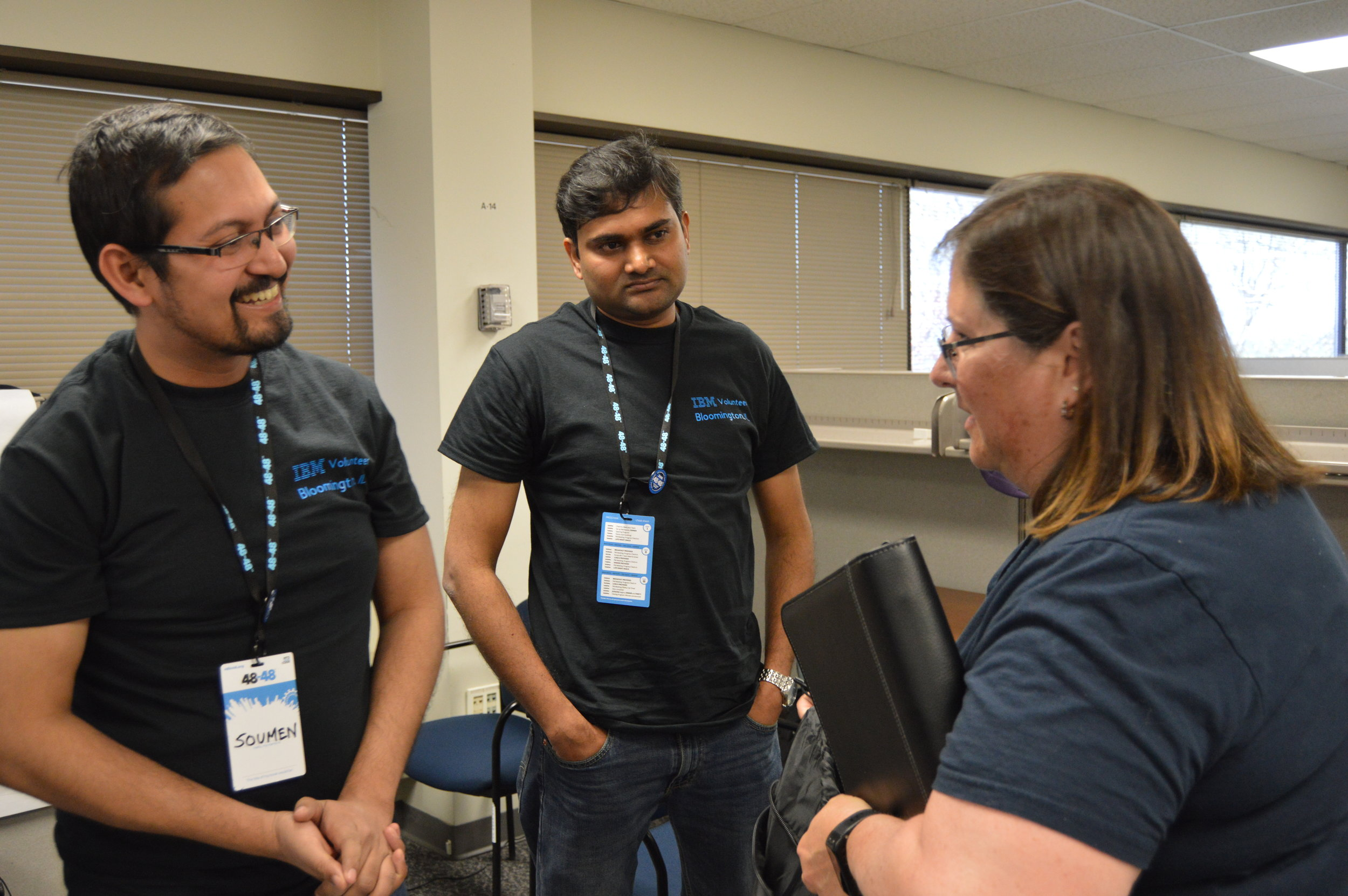 Michele Evans, communications and grants coordinator for the Illinois Prairie Community Foundation, meets Saturday with the volunteer team building the foundation a new website during the 48in48 Hackathon at Rivian Automotive in Normal. (Photo: Breanna Grow/AdaptBN)