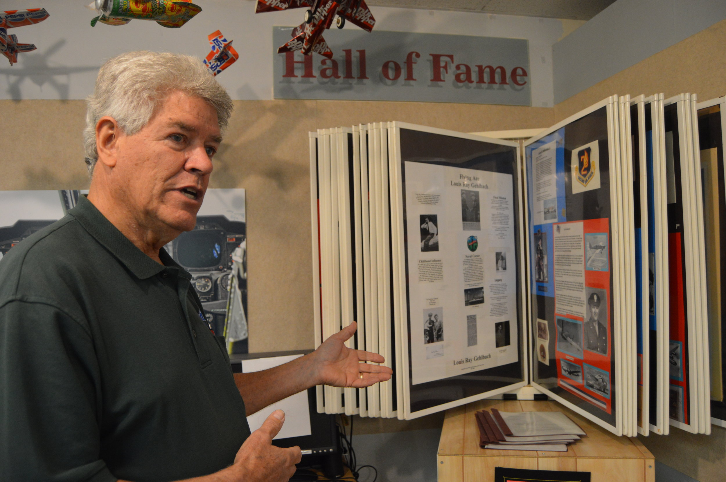 Prarie Aviation Museum President Doug Reeves shows the museum's Hall of Fame, a catalog of McLean County residents and their place in aviation history. (Photo: Breanna Grow/AdaptBN)