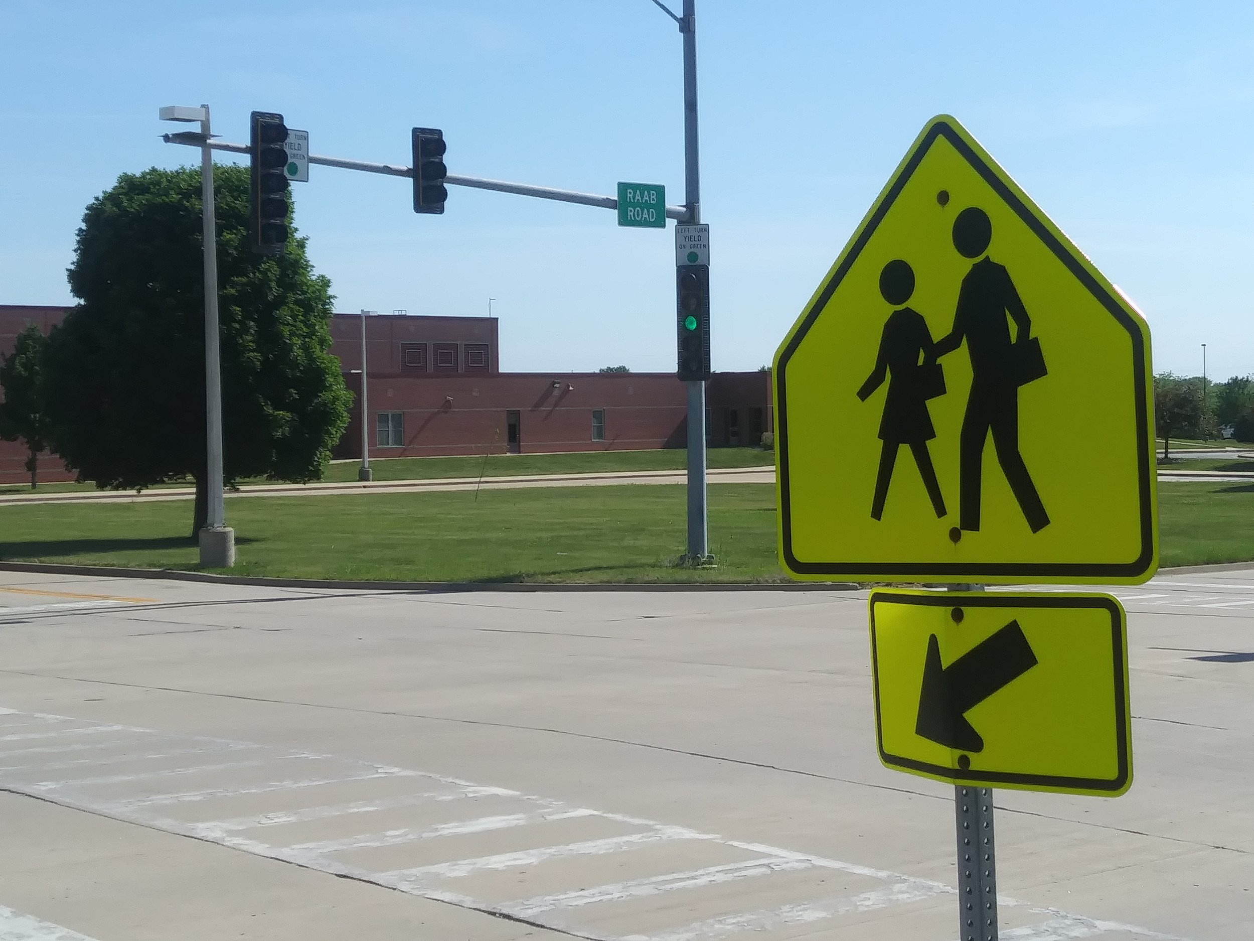 Normal will outsource its school crossing guard program at various Unit 5 schools beginning this upcoming school year. (Photo: Breanna Grow/AdaptBN)