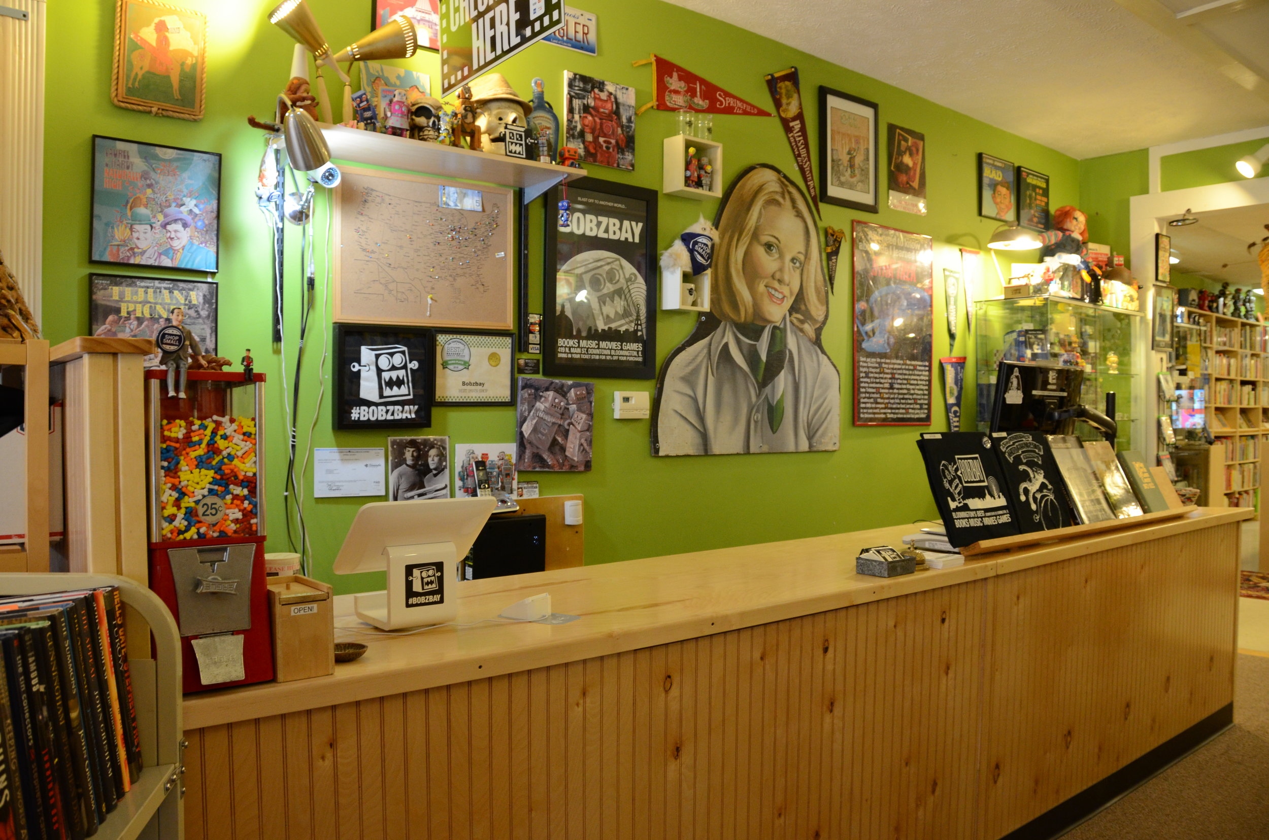 """Bobzbay's front counter, with the """"larger-than-life""""wood cutout of a woman (Photo: Breanna Grow)"""