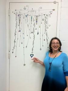 Joanne drew her beautiful dangles on the store door.