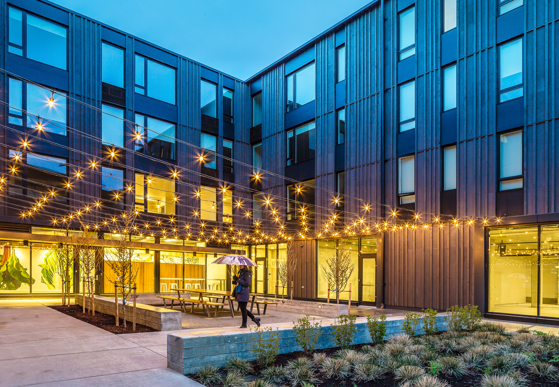 Lents Commons. Commissioned by Portland Development Commission. A collaboration between Prosper Portland and the Portland Housing Bureau.  Highlighting the mixed-use, mixed-income project with 54 units of housing and approximately 7,500 square feet of retail space on the ground floor.