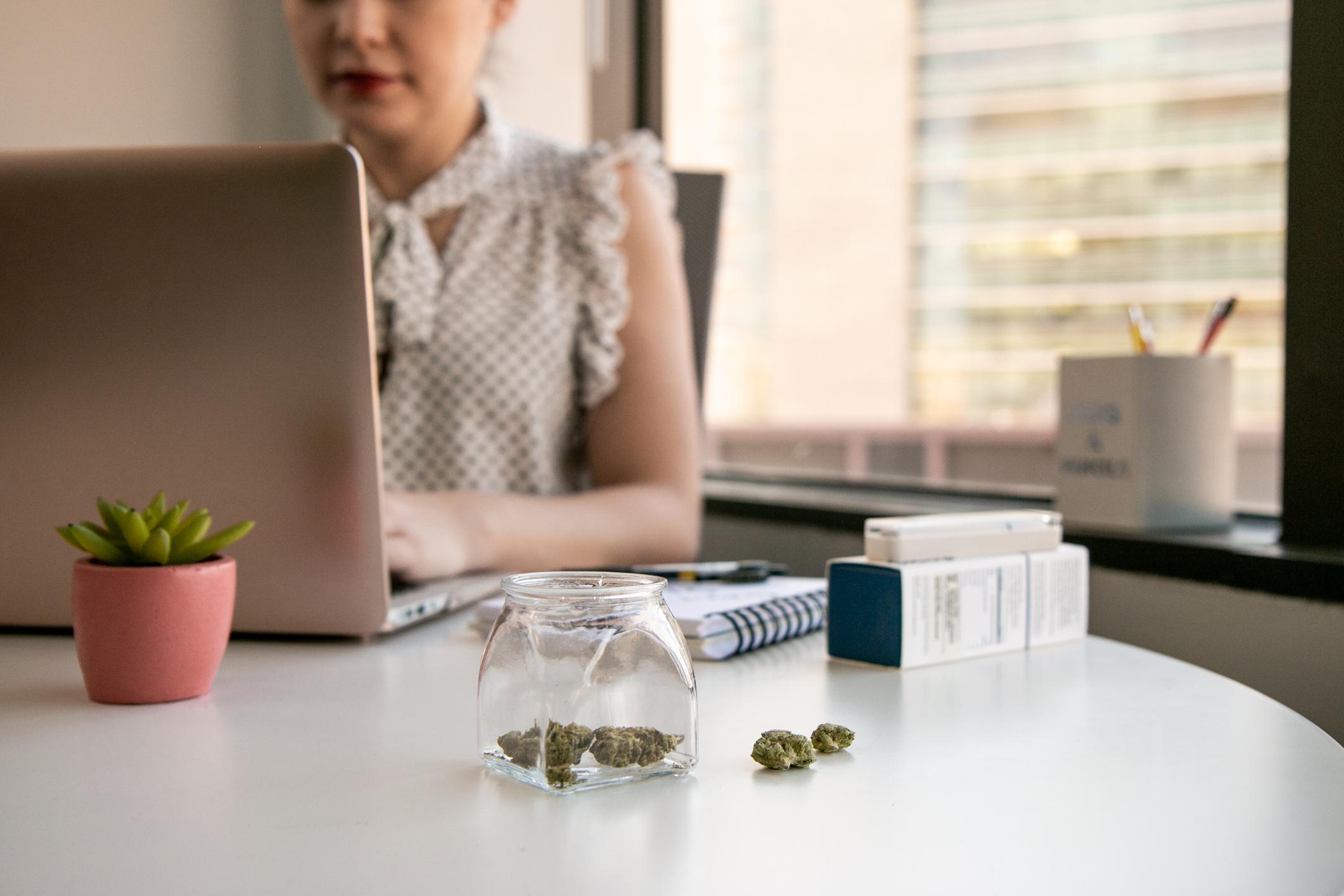 Female-Cannabis-Entrepreneur-working-on-Marketing-for-Marijuana-Business-in-Bright,-Soft-Lit-Office-1129397827_2125x1417.jpeg
