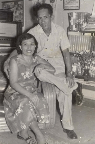 Eliza and alejo in their home in tamuning, guam.