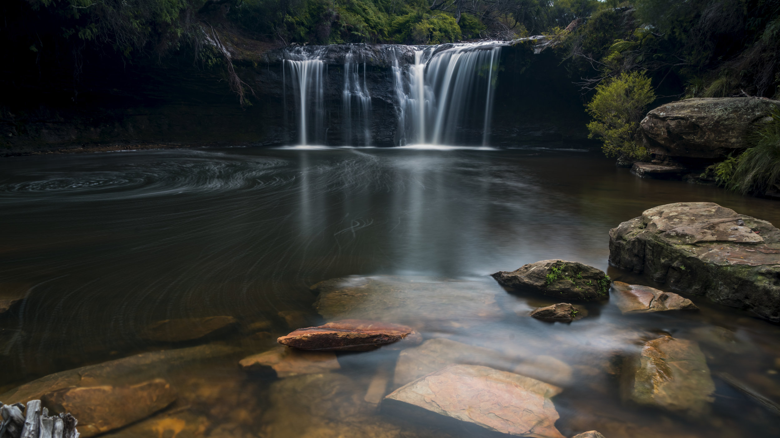 One of the more peaceful waterfall spots on the south coast, Nellies Glen doesn't have much going for foreground interest. I used a polariser to reveal the colourful stones under the surface and used them for my foreground.