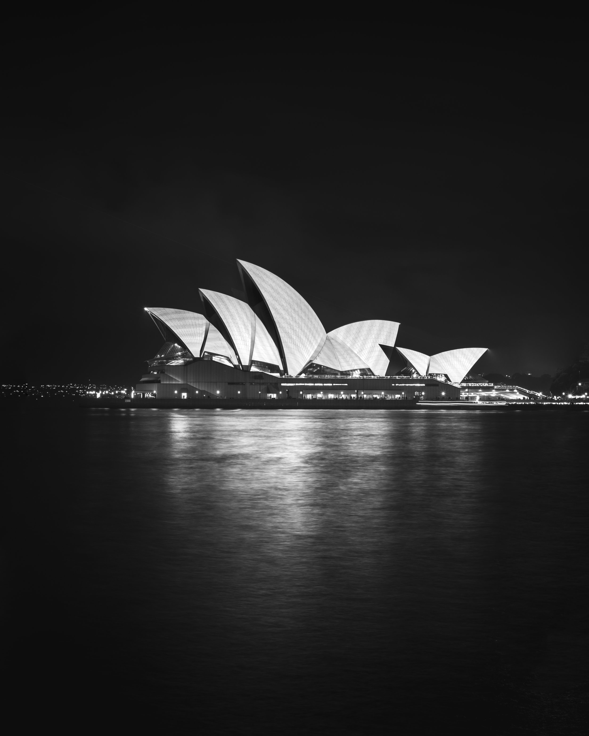 Using the Burn tool (midtones and shadows) I was able to preserve the details in the sails of the Opera House without killing the brightness of the whites.