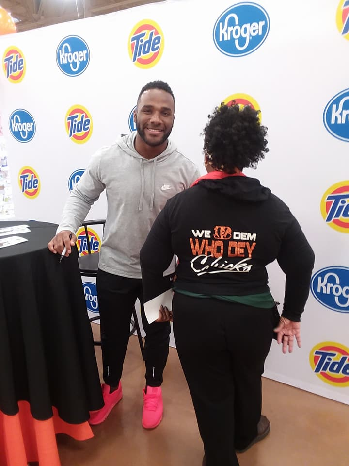 "Who Dey Chick ""Bree"" with Cincinnati Bengals running back Giovani Bernard"