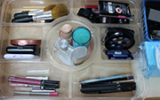 Here is an example of a plastic appetizer container that I reused as a make-up organizer.