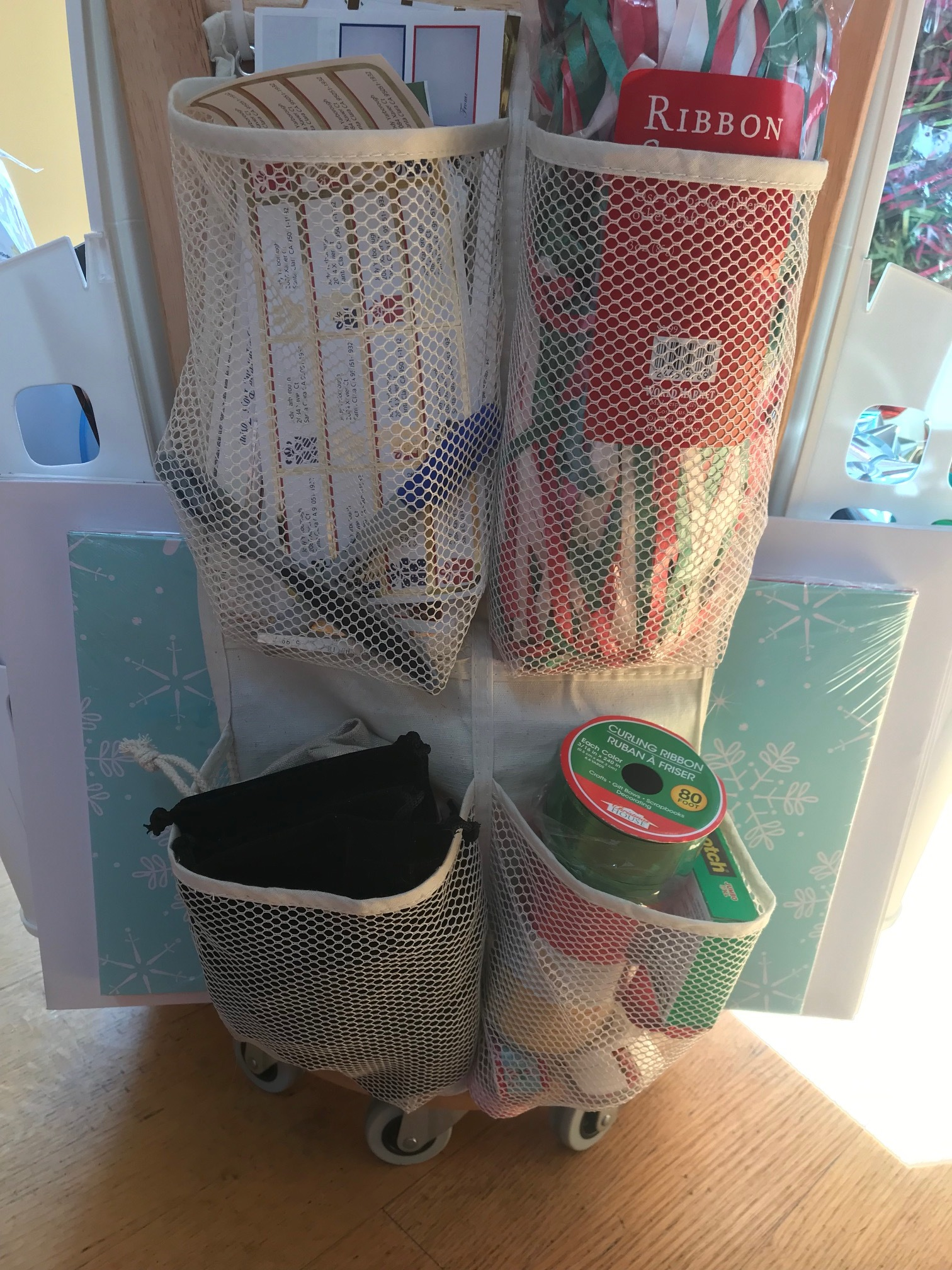 This side holds labels, extra supplies and other miscellaneous small items in mesh pockets of an over-the-door shoe organizer that I cut down to size.