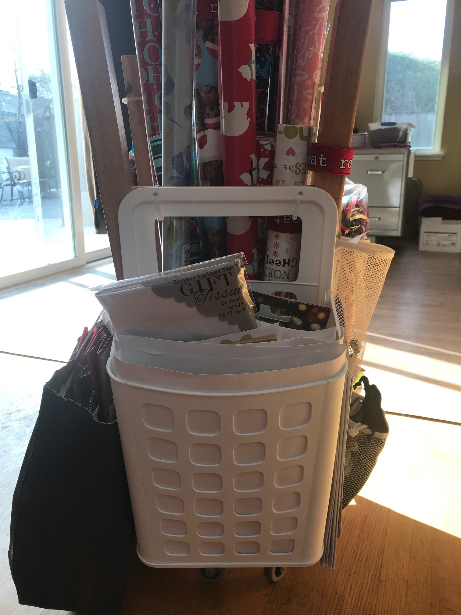 This is a plastic hanging organizer I bought from IKEA that is intended to hold plastic bags for recycling. I'm using it to hold flat items such as flat gift-wrap, tissue paper, labels and smaller gift bags.