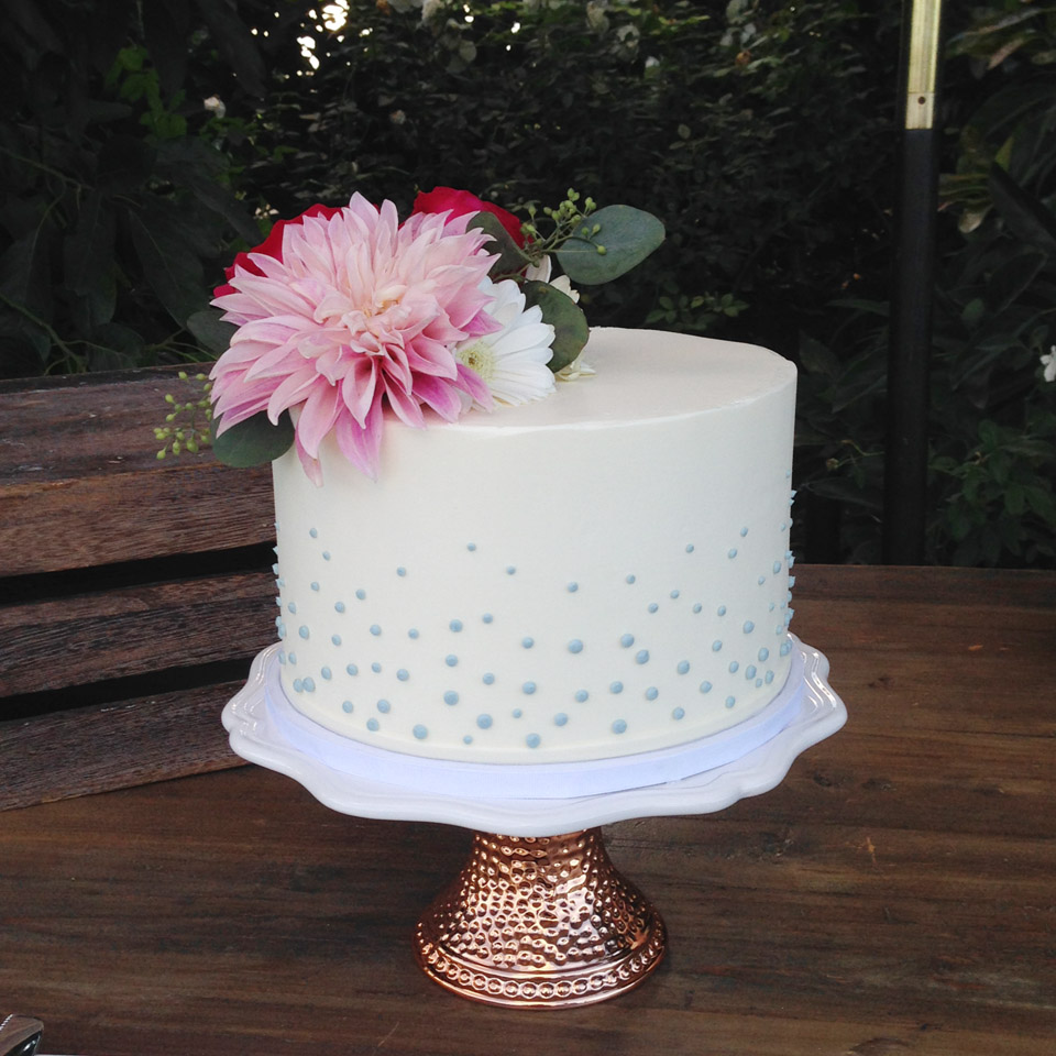 Single tier buttercream blue dots.jpg
