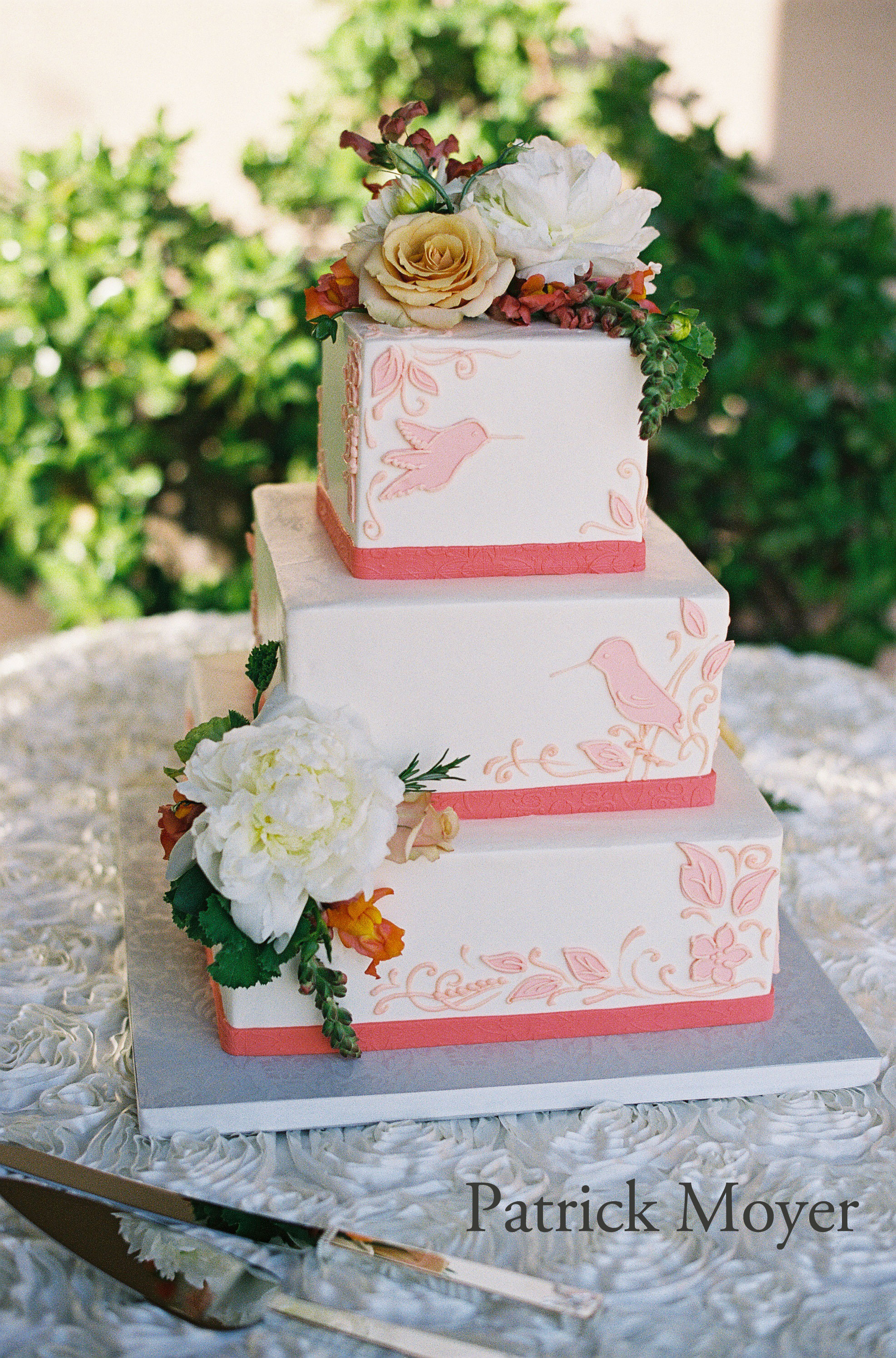 Square-tiers-with-blush-&-coral-birds.--Photo-by-patmoyerweddings.jpg