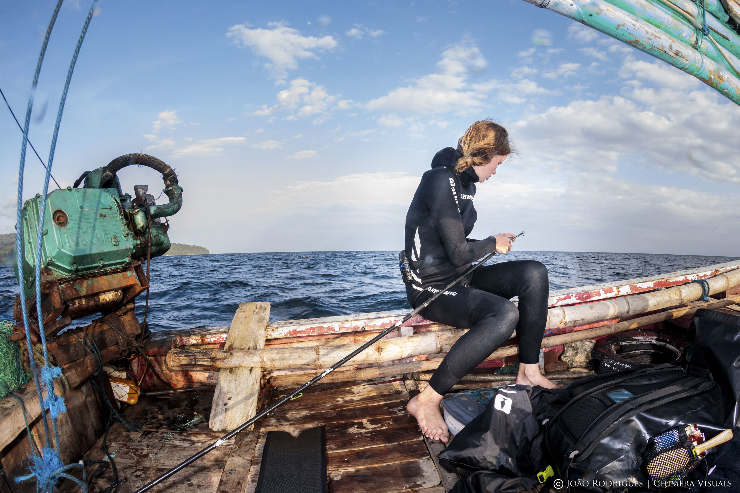 Betty setting up her pole to attach a tag to a mobulid ray in Indonesia.   Photo by Joao Rodrigues.