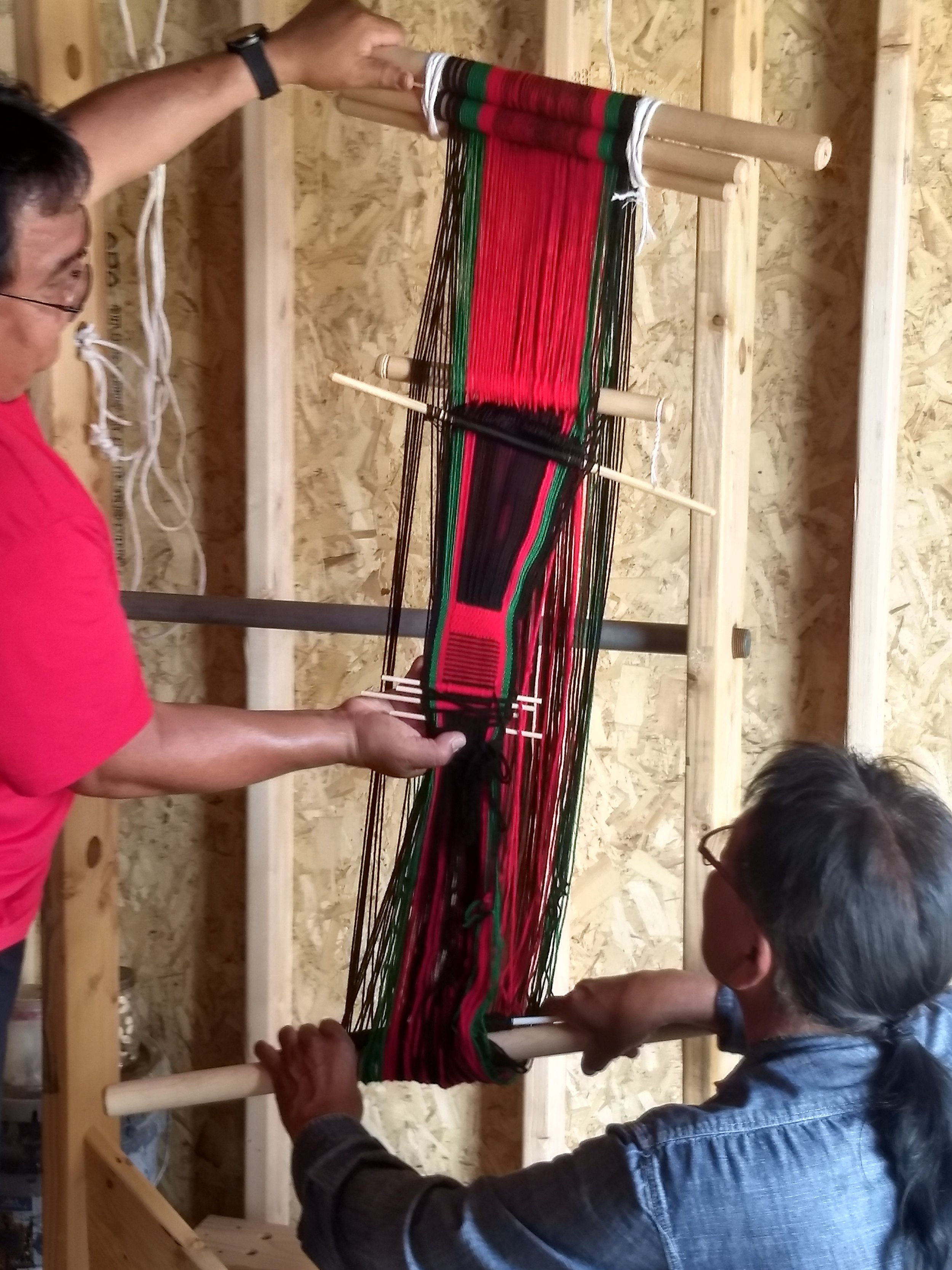 Augustine and Lendrick  with loom.jpg