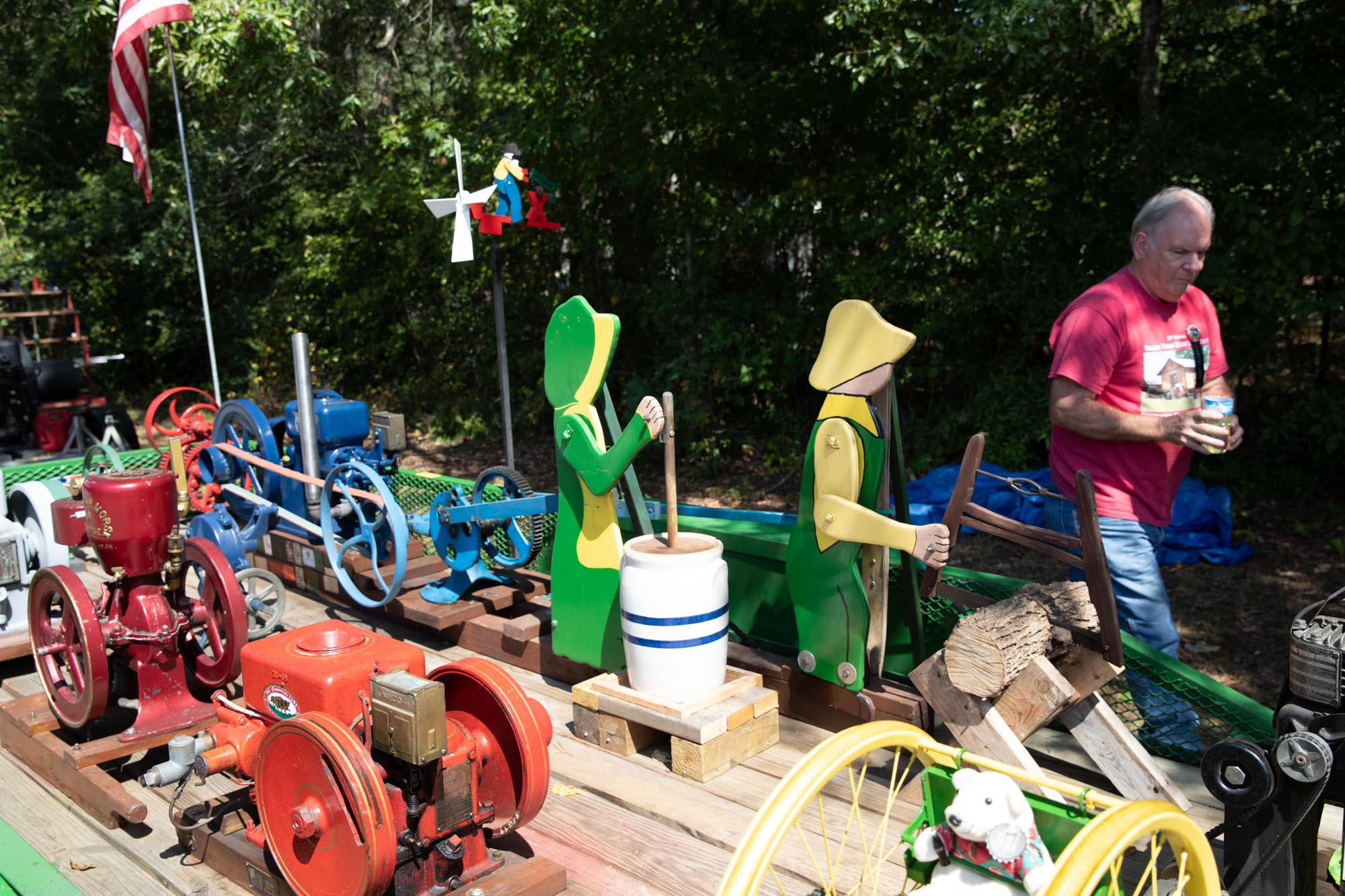A collection of make and break engines with one driving a milk made and a woodsman.