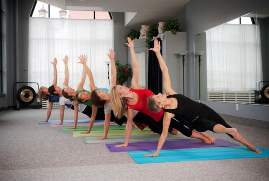 yoga group posed on mats 538px.jpg