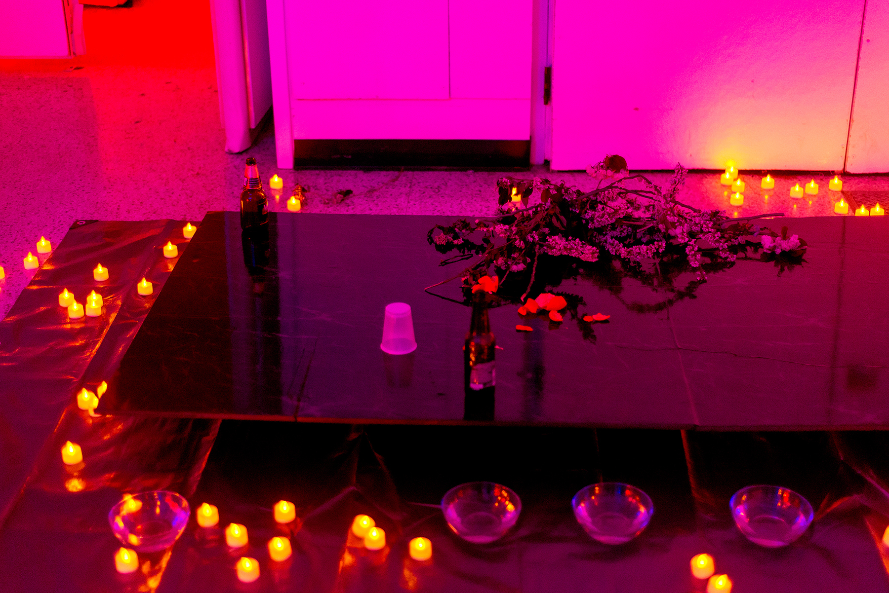 The marble altar in the early moments of the party, adorned with cherry blossoms and rose water
