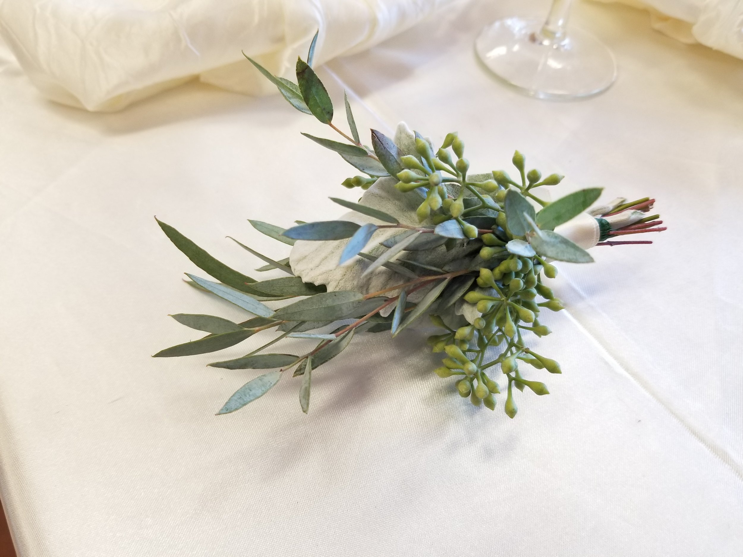 Boutonniere in all greens, olive and eucalyptus leaves