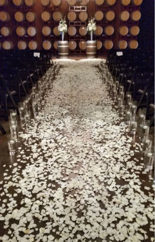 Wine Cave ceremony aisle, glass cylinder floating candles, rose petals and wine barrel toppers, Palm Event Center wedding ceremony