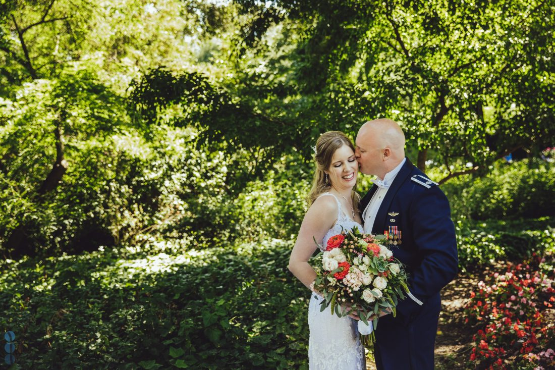 Lush gardens and sweeping lawns at Madrona Manor in Healdsburg. Bouquet of flowing green foliage with pops of bright coral ranunculus mixed with soft blush garden roses.