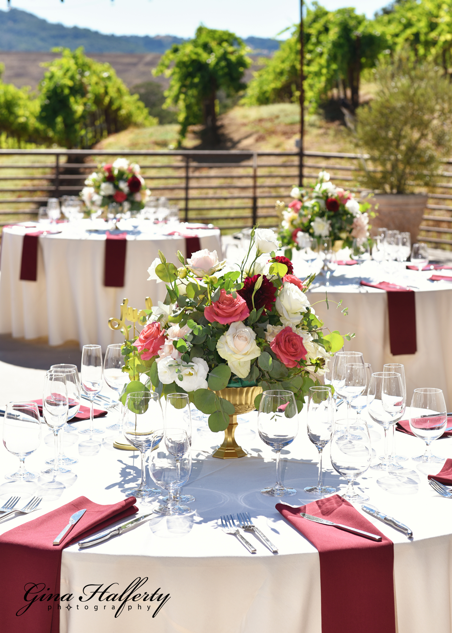 Centerpiece, gold compote container with fresh summer flowers in blush and white with pops of coral and burgundy. Sbragia winery Geyserville