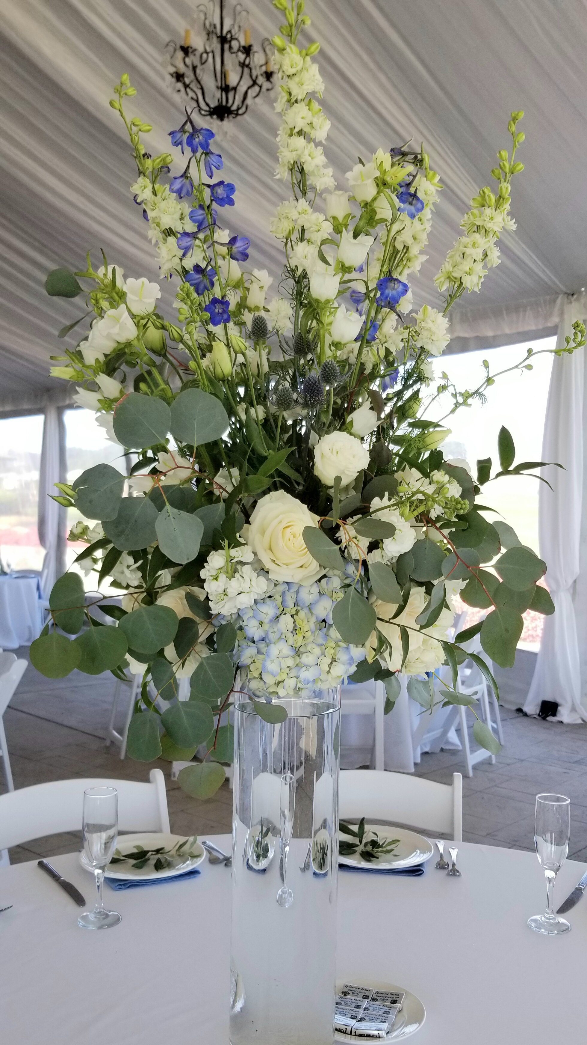 Tall table centerpiece featuring white and blue flowers, Eagle Vines Golf Course