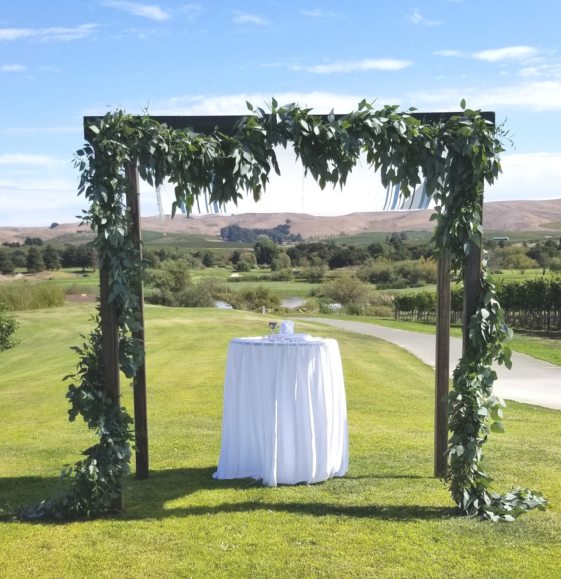 Chuppah loaded with lush eucalyptus garland, Eagle Vines Golf Club, American Canyon