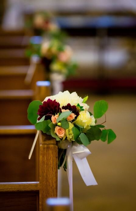 Church pew flowers, hand tied bouquets attached to the pews along the aisle. Sonoma, CA