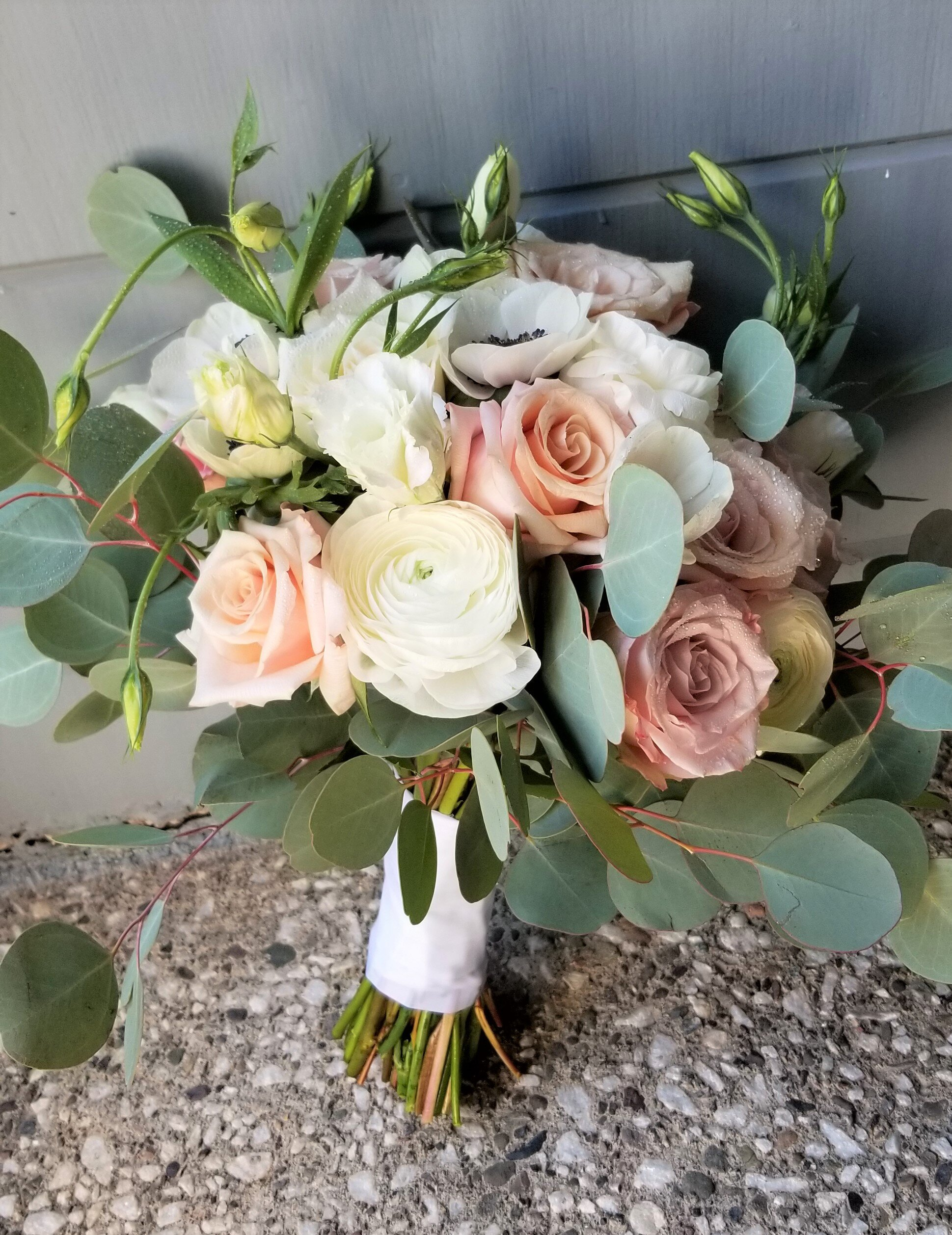 Hand gathered bouquet, peach, mauve and white flowers, satin ribbon wrap.