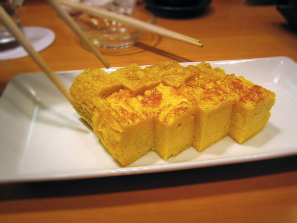 Tamagoyaki is a type of omelette made by rolling together several layers of cooked egg.