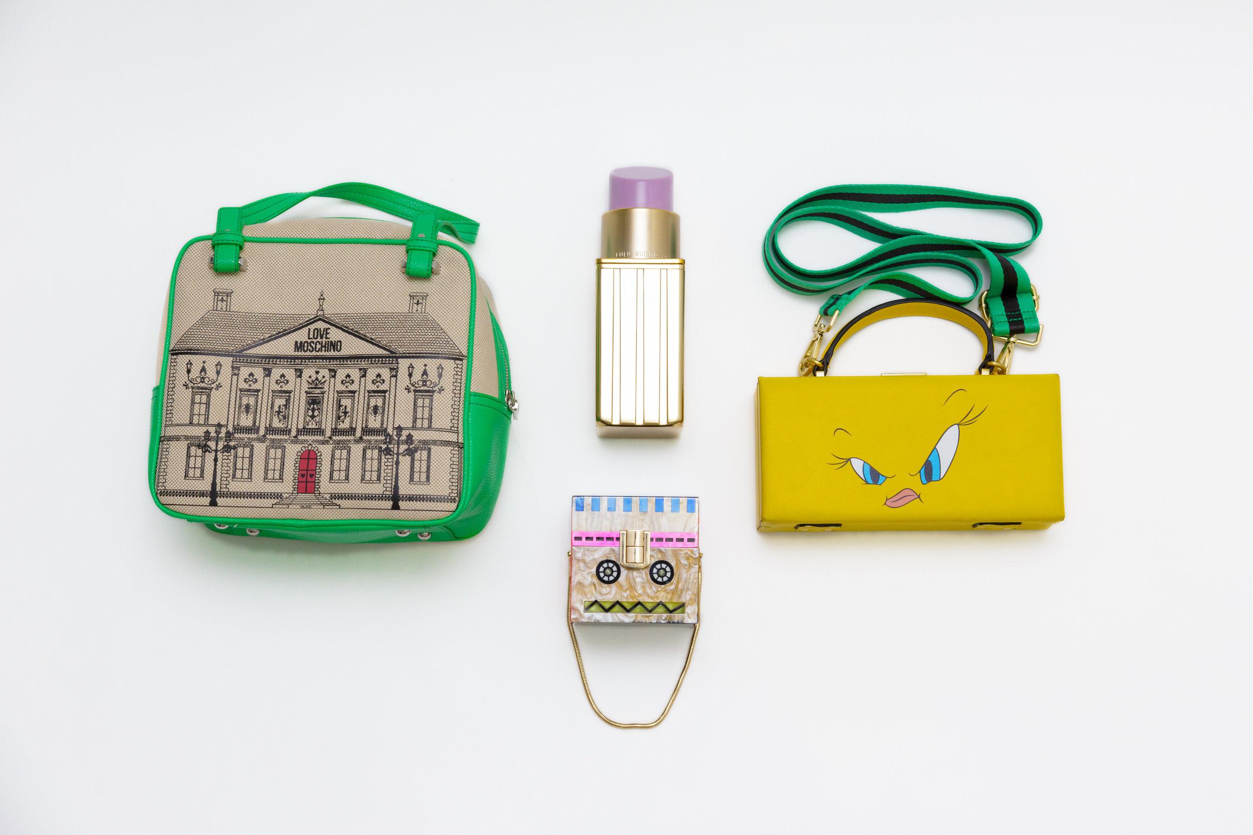 Love Moschino Handbag |    Moschino    (similar), Lipstick Clutch |    Lulu Guiness    (similar), Tweety Bird Guitar Strap Bag | Zara (sold out), Robot Box Clutch | Zara (sold out)