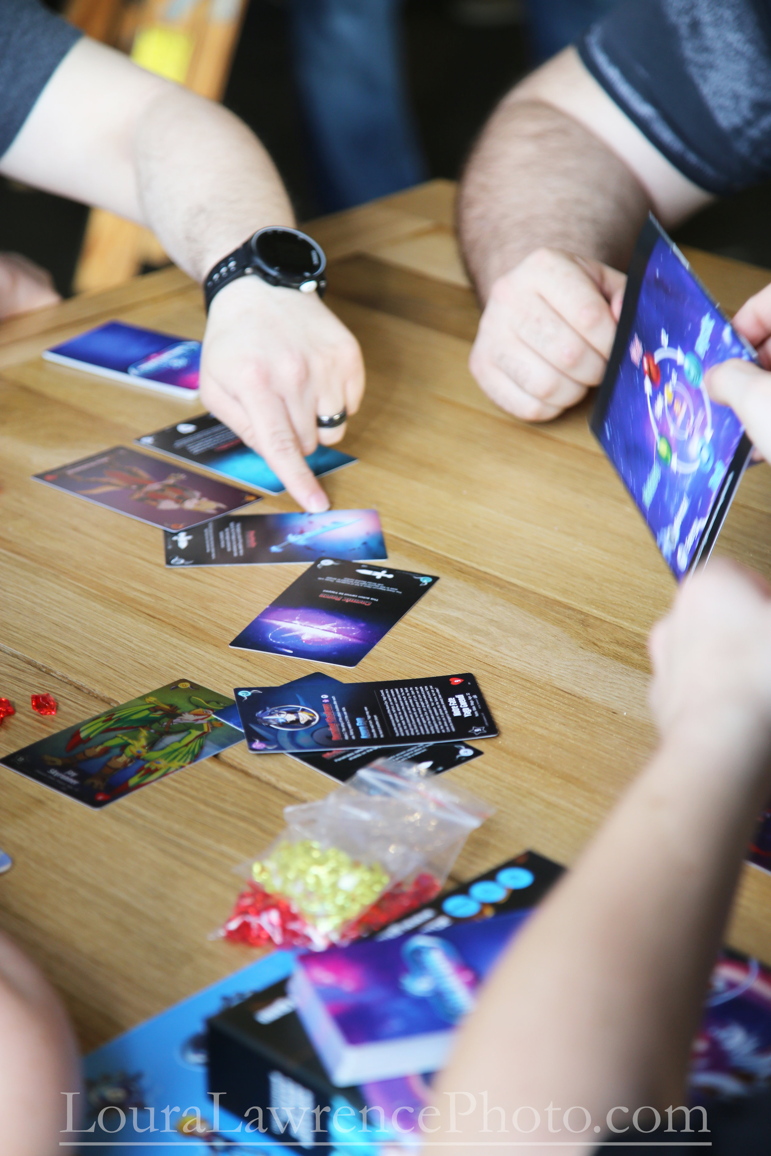 """Patrons play the new """"Galatune"""" game, during it's launch party at the D20 Bar in Kettering, Ohio."""