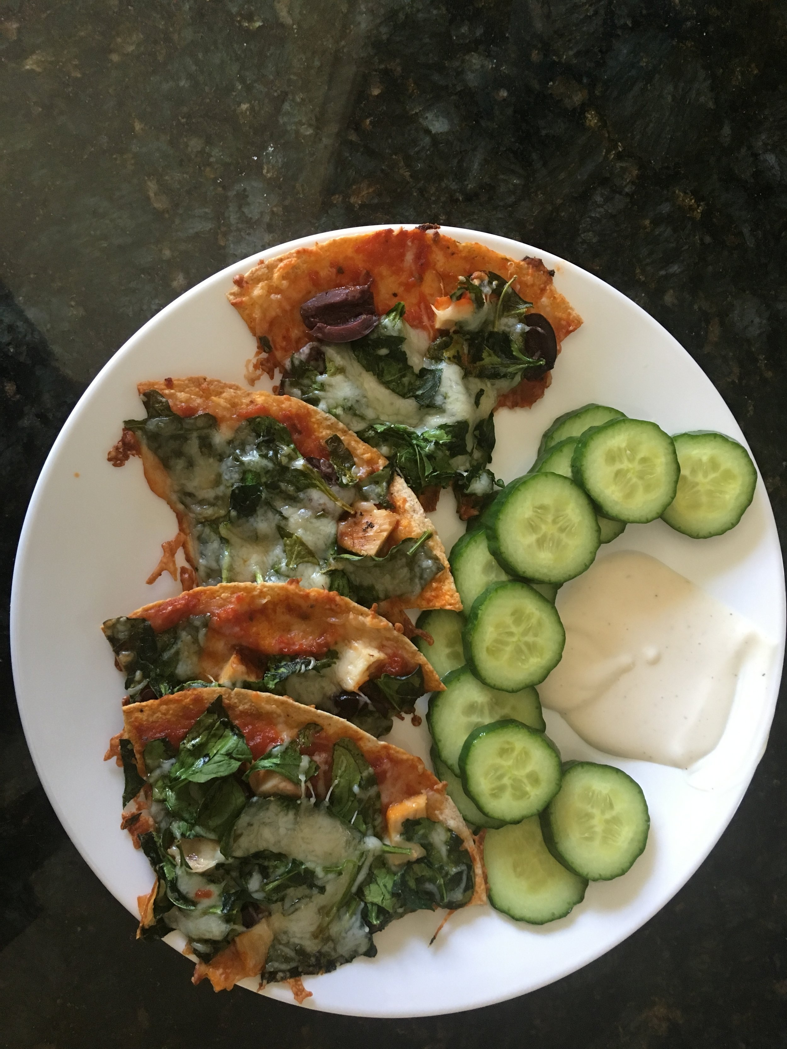 Greek Pizza - Preheat to 425.Olive Oil/SprayOle Health & Wellness Tortilla1/8 cup Rao's pizza sauce1 Serving Kalamata Olives2-3 Ounces of Chicken1/2 Cup Spinach1/2 Cup Shredded Cheese