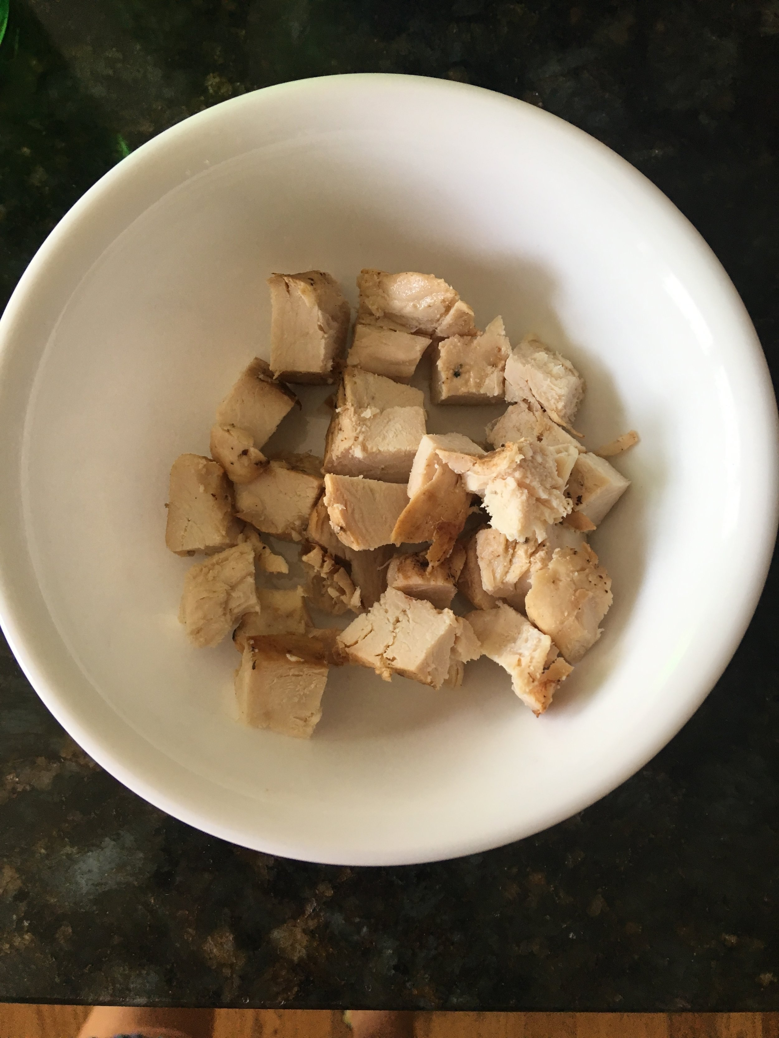 Step 1 - Place chopped chicken (2-3 ounces) in a bowl.