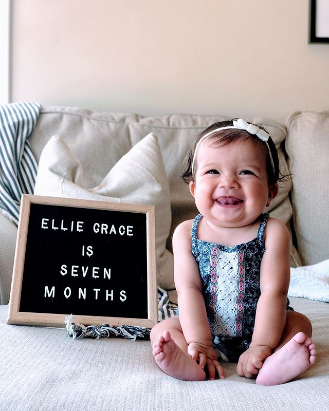 7 Months || Is she not IRRESISTIBLE?! I could cry! 😍 Ellie's officially graduated from her helmet! We are so grateful to say GOODBYE to weekly appointments, heat rash, constant cleaning of the helmet, and HELLO to showering that sweet face of hers in kisses (and now I get to dress her in all the bows again 🥰)! I'm so proud of my girl and how adaptable she proved to be through this whole process! She even finished her treatment 2 weeks early. What an overachiever 😉. Some of our favorite things are her scrunchy nose smiles, how she talks and gurgles when she's tired (at an unashamedly loud volume might I add...girl's got pipes!), and when she rests her head on mommy or daddy's chest. She loves when people talk to her or sing to her and watches in wide-eyed amazement. Her interest in Harvey has grown and she even reaches out to pet/grab him - which Harvey lovingly tolerates...for a few seconds 😋. Life is so rich with this gorgeous girl! #elliegracehagen #oneyearofelliegrace