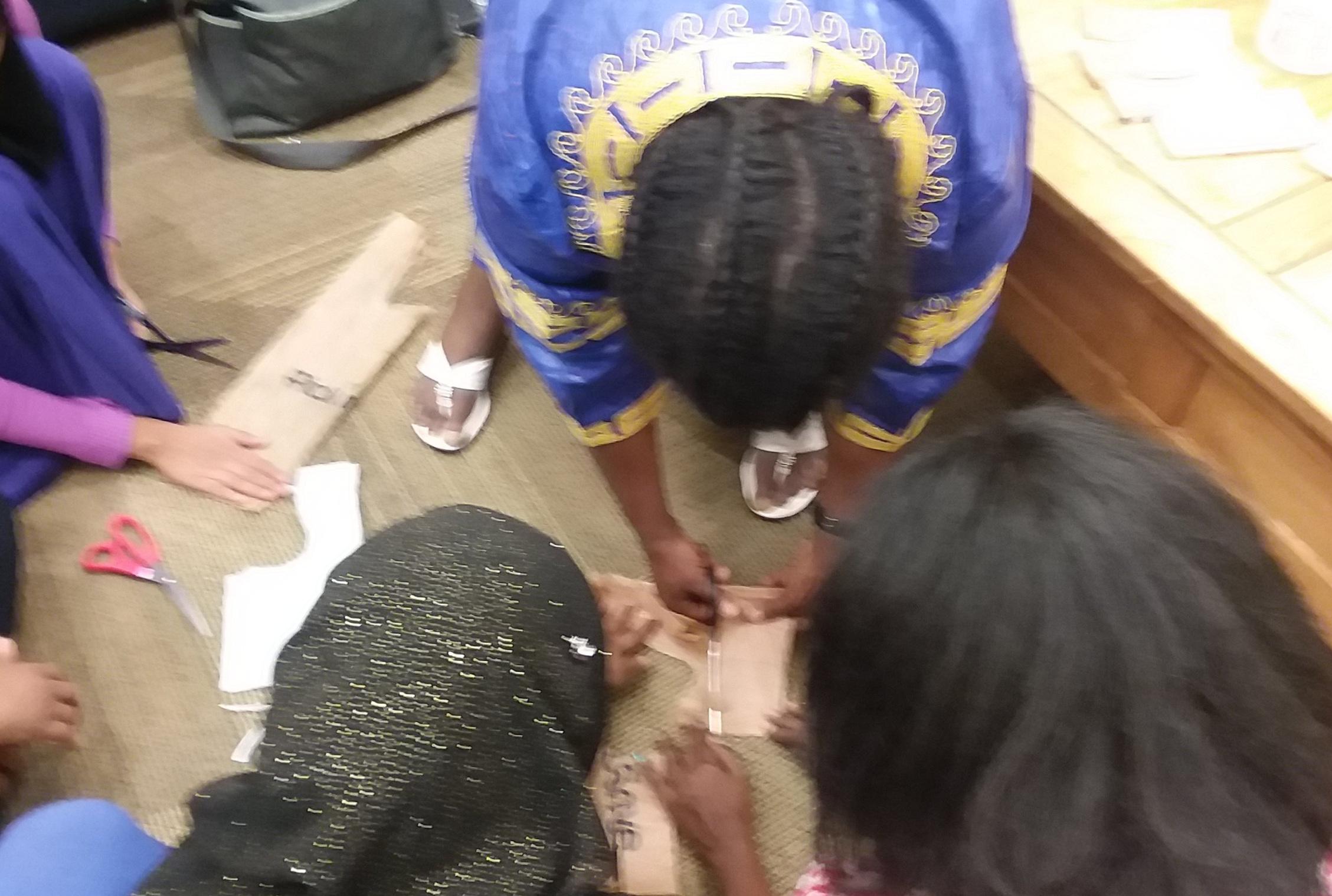 Demonstrating how to crochet using plastic bags
