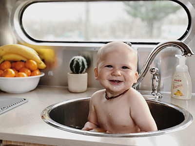 Just when you thought sink baths couldn't get any cuter! Since we don't have a tub, we make use of the large sink for baths for the baby. Believe it or not, it's big enough for our toddler too!