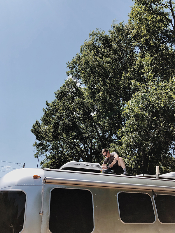 Installing our Winegard ConnecT 2.0. Jacob loves an excuse to get on the roof of the Airstream!