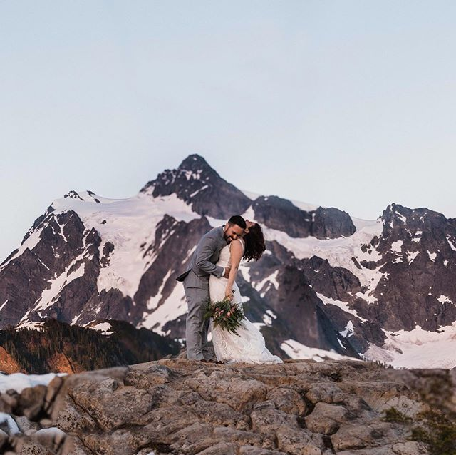 "🌲IMPORTANT STORY OVER HERE! 🌲On Friday Katie and Max said those ""I dos"" on a rooftop in Ballard and last night we adventured to the mountains, wedding attire and all, to keep the party going. For months they had their hearts set on Mount Rainier for this wedding adventure session butttt the weather had different plans. I updated my weather app an obnoxious amount of times all weekend and after texting back and forth about other options, Katie texted me and said, ""What do you think is best?"" I made the decision to recommend this location based on weather even though it was an extra hour drive for my couple. SO dang thankful these two were up for the adventure because Mother Nature really came through. At the end of our session, I looked at Katie and Max and said, ""Wait.....we are still going to hang out right?"" They laughed and agreed that it was only the start of our friendship. From their engagement session, wedding, and post-wedding adventure session, I have absolutely loved getting to know these two and their two pups. (PS- go ahead and swipe to the last frame to see just one reason these two are the real MVPs) . . . . . . . #betweenthepine #pnwonderland #adventureelopement #washingtonelopementphotographer #allaboutadventures #adventureelopementphotographer #adventurouslovestories #wanderingweddings #washingtonweddingphotographer #elopementphotographer #seattlephotographer #greenweddingshoes #oregonweddingphotographer #coloradoelopementphotogrpaher #artistpoint #thegreatpnw #wandererscommunity #pnwweddingphotographer #oregonelopementphotographer #californiaelopementphotographer #wedventuremag #adventerouswedding #destinationwedding #thatpnwlife #wanderwashington #mountbaker #mtbaker #mtbakerwilderness"