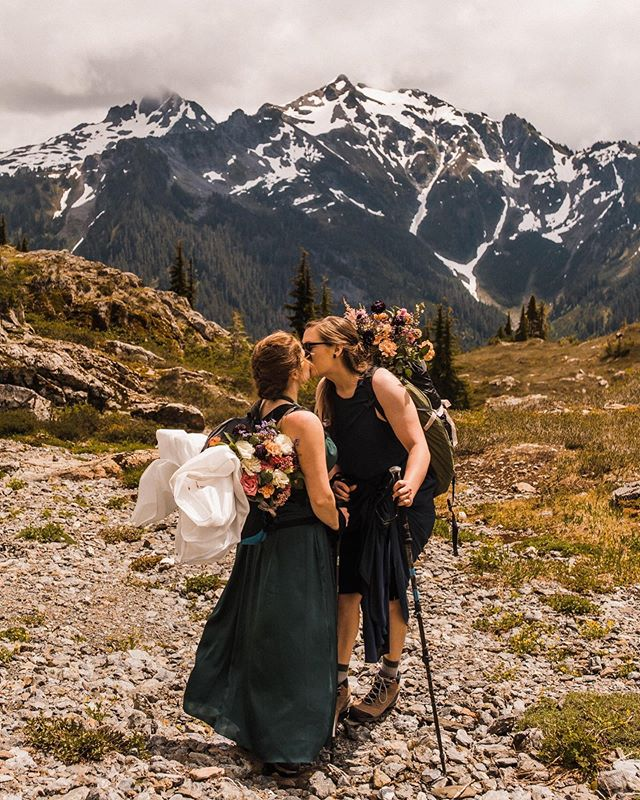 "Who says you have to wear a white dress on your wedding day? And, who says you can't have a mountain elopement with all of your favorite people by your side at the same time? Sierra and Vanessa's elopement was one for the books. Neither of them felt that a white dress portrayed their personalities, so beautiful green and blue dresses it was. They knew they wanted to elope in the North Cascades, and they also knew family would want to be by their side. So they said, ""Heck yes! Everyone, grab your hiking boots because we are going on an adventure!"" This was such an epic day and so much fun seeing a couple make their wedding day exactly what they wanted it to be. I can't wait to share their full story on the blog in the coming weeks! VENDORS: Planner: @thegreatestadventurewed  HMU: @makeupartist.angela  Cake: @saltadenabakery  Cabin reception venue: @airbnb  Catering: @haggenmarketstreetcatering  Rentals: @cortpartyrental & @bbjlinen  Dresses: @verawang  Florist: @thegreatestadventurewed . . . . . . . . #betweenthepine #seattleweddingphotographer #pnwweddingphotographer #wellwedmagazine #portlandweddingphotographer #oregonweddingphotographer #greenweddingshoes #wedventuremag #elopementphotographer #wanderingweddings #washingtonelopementphotographer #washingtonweddingphotographer #authenticlovemag #intimiatewedding #adventureelopement #weddinginspiration #bellinghamweddingphotographer #weddingphotographer #lookslikefilm #ohwowyes #adventureelopement #adventerouswedding #adventurewedding #destinationwedding #sheexplores #pnwwonderland #allaboutadventures #coloradoelopementphotogrpaher #californiaelopementphotographer"