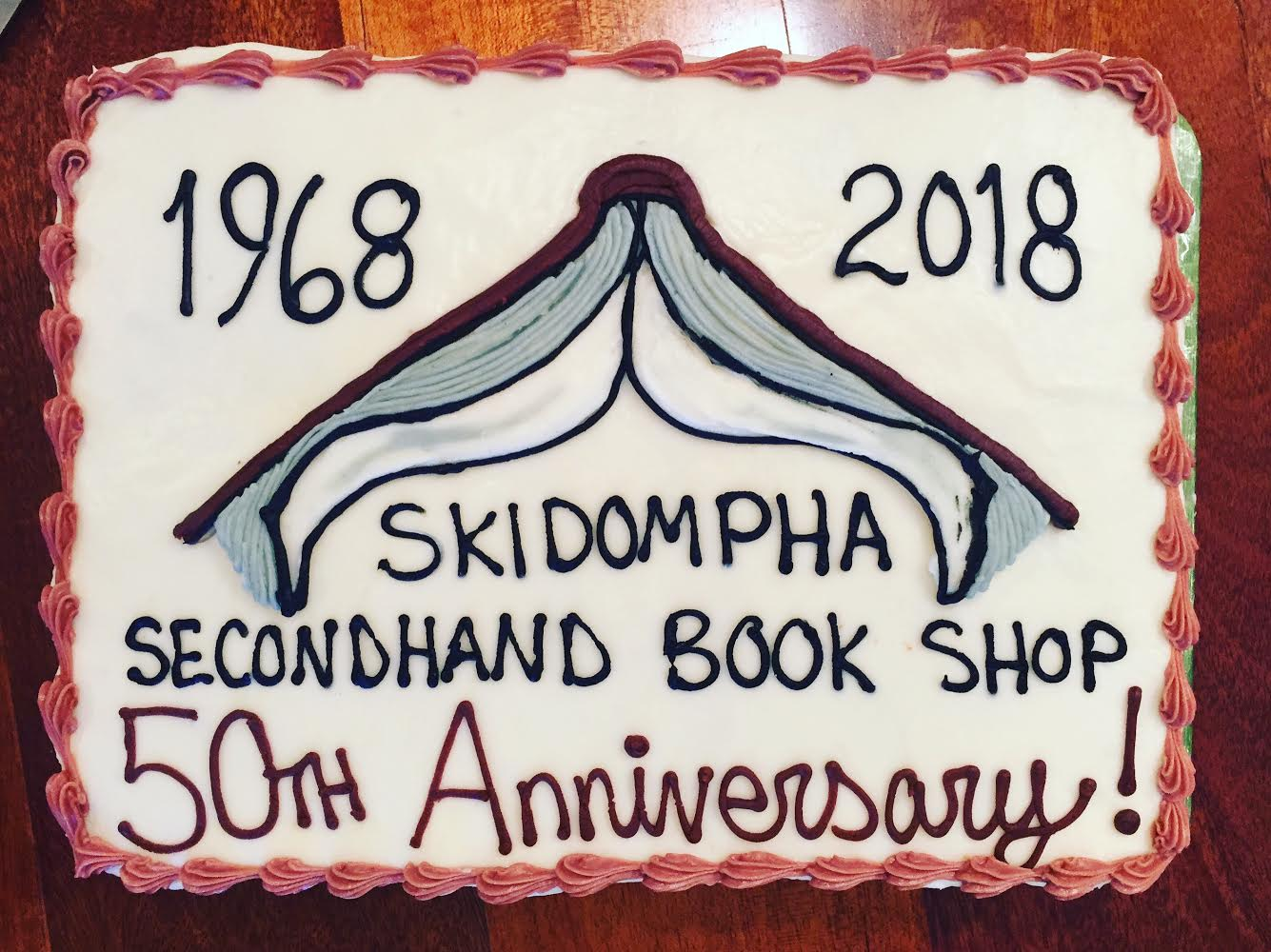 Skidompha Secondhand Book Shop's 50th Anniversary Cake (inspired by the new sign by Jacques Vesery) by  Barn Door Baking Co.