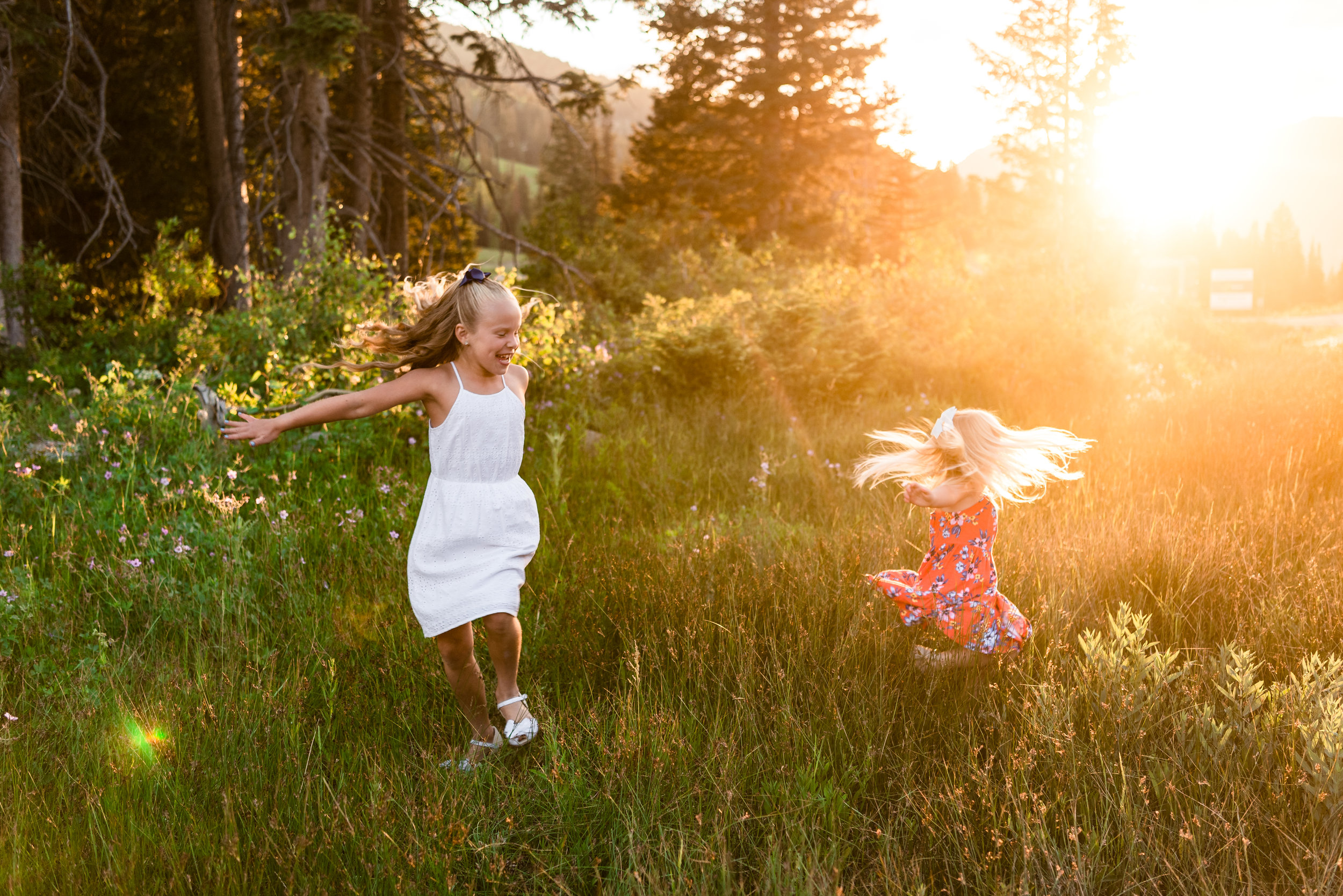 As we were packing up the sun took one last gorgeous peek through the canyon and I asked the girls if they would like to dance in the grass. It took zero convincing! They took off and we snagged a few more playful pictures in the last sun of the day. Hello summer sun, we love you!