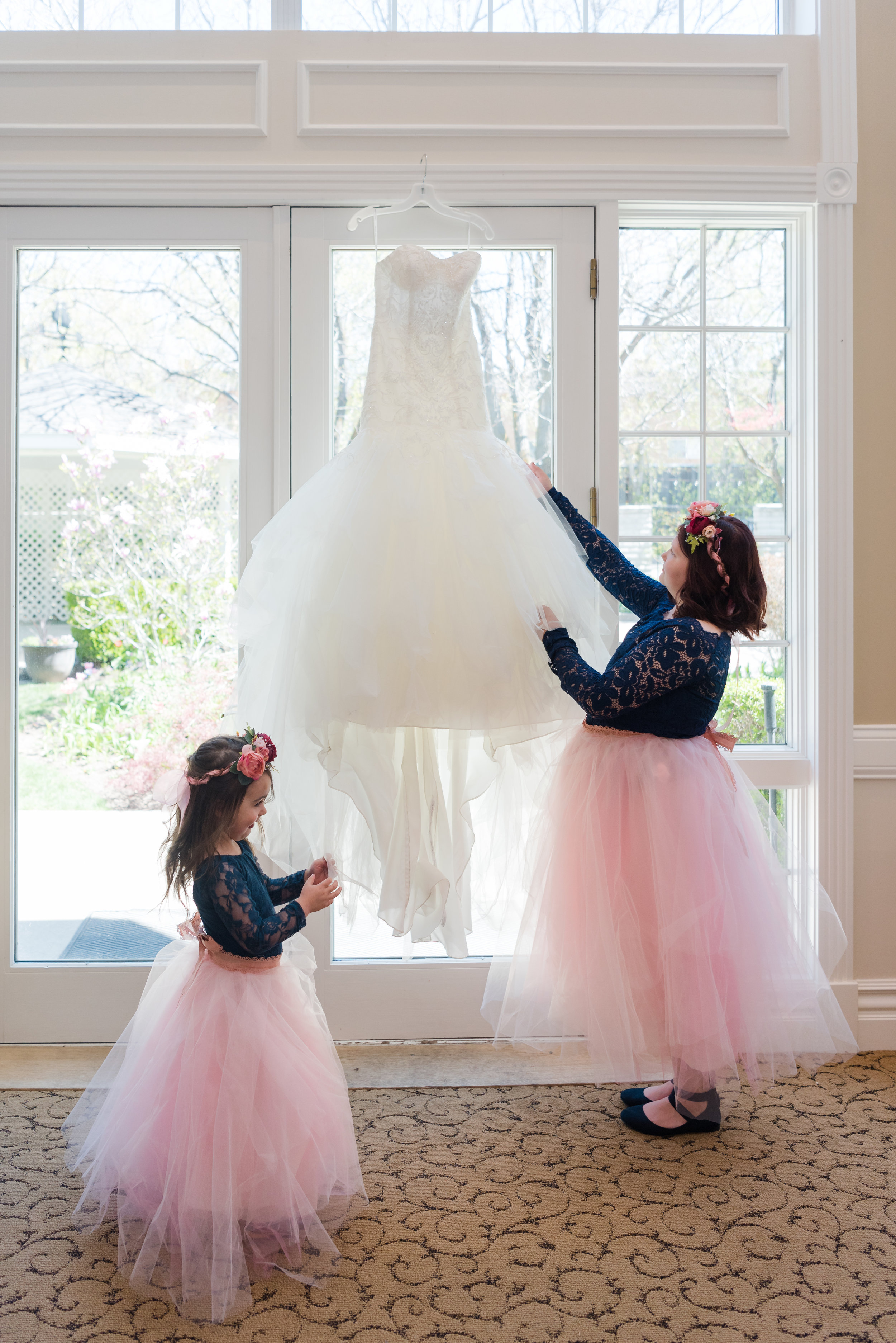 While taking pictures of the brides dress the flower girls wanted to see and help. One day girls, it will be your turn to be the bride!