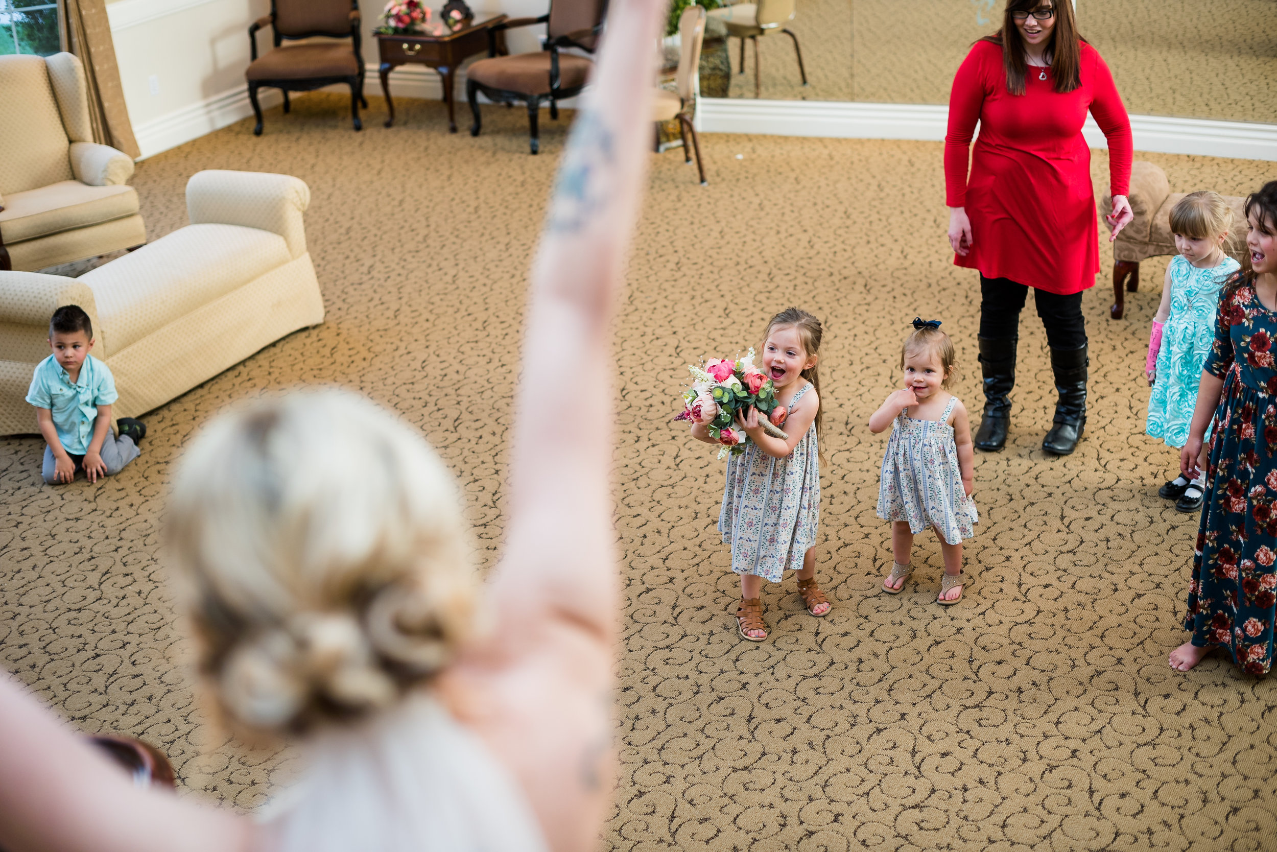 And look how happy this little doll is that she got to hold the bouquet, too!